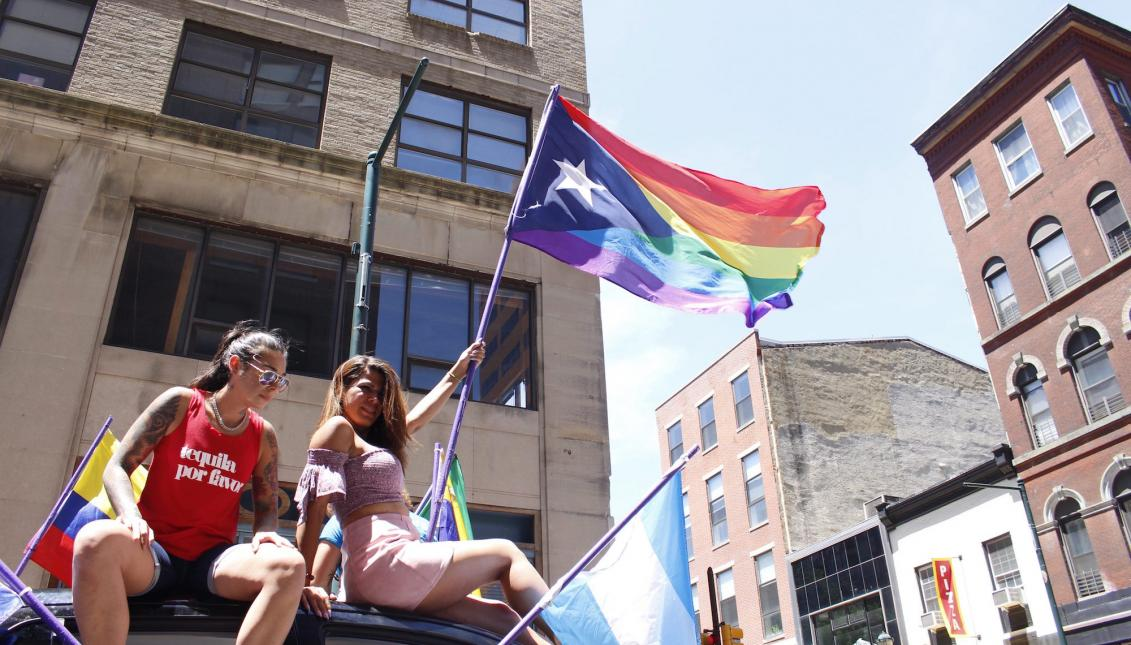 A picture of TINGS program manager holding Philadelphia Pride Flag